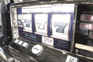 A slot machine showing three 7s