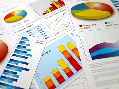 An investor's pile of stock portfolio data and charts.