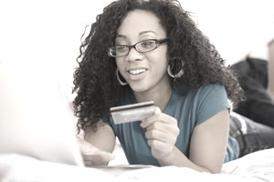 Woman using her first credit card online
