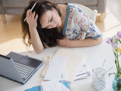 Stressed woman paying credit card bills