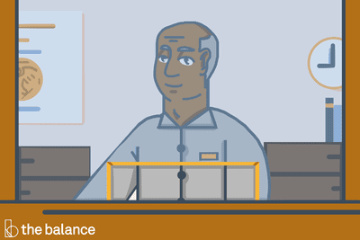 Image shows a bank teller behind glass.