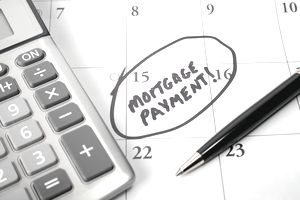 Biweekly mortgage payment reminder written and circled on a monthly calendar