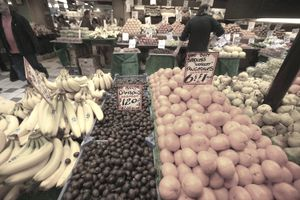 A produce market displays a wide variety of food