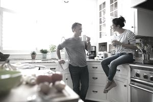 a couple conversing in a kitchen