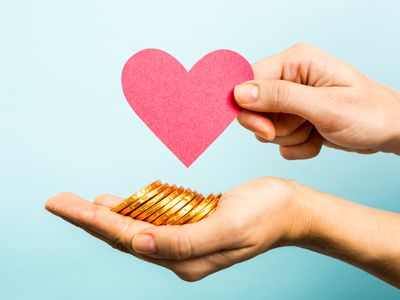 Golden coins, red heart paper shape. Love and money concept