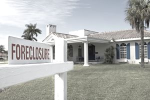 A home with a foreclosure sign where the owner can use equity of redemption process to reclaim.