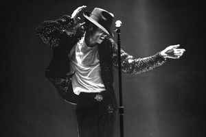 Michael Jackson performing on stage in black and white