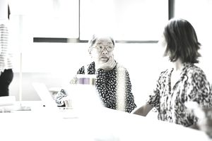 Businesswomen in discussion while working in an office