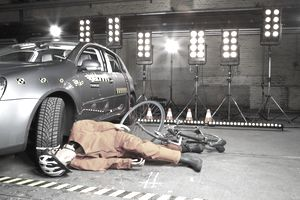Dummy in car accident with bicycle, representing car insurance liability coverage.