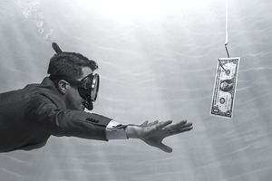 Man swimming toward dollar bill