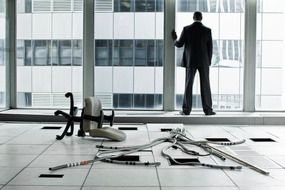Businessman in abandoned office after he lost funding for the building.