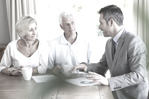 A couple meets with a financial planner.