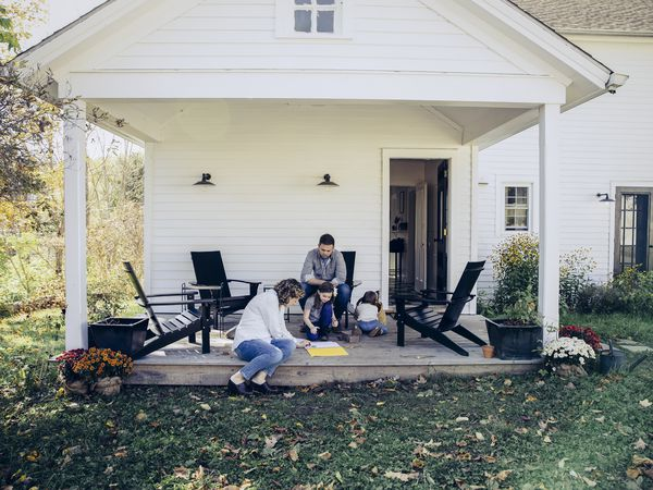 Family spending time together on front porch of home