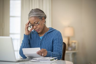 A woman tries to calculate her taxes