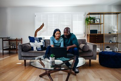 A mature mixed race couple in their suburban home, spending the day together - Los Angeles, USA. Part of a series.