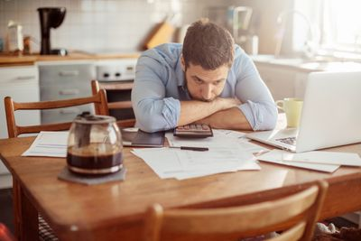 Man worried about an IRS tax levy from his paycheck