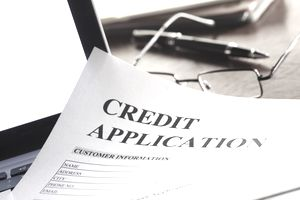 Credit application paper on laptop