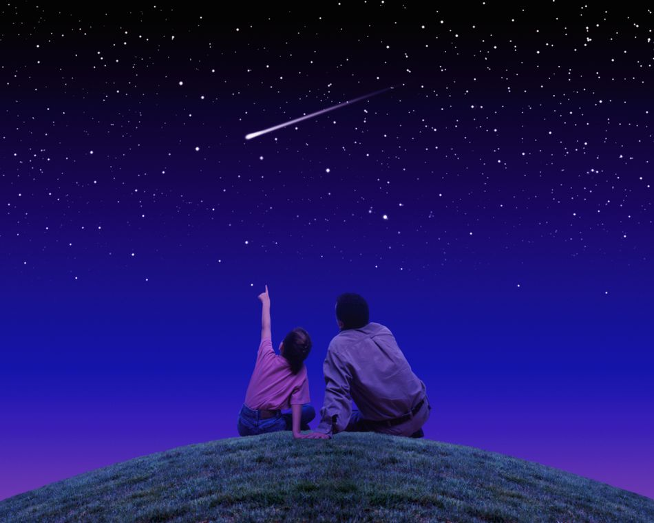Father and daughter stargazing.