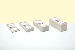 Stacks of US bills in ascending order