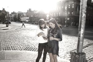 Friends looking a map on smartphone in New York