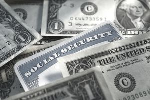 Social Security card surround by cash, representing tax on Social Security payments.