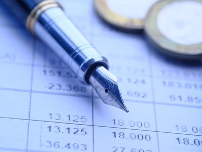 A pen and paper of income statement analysis