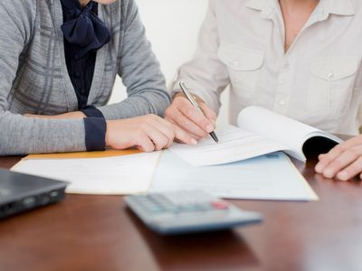 a couple of businesswoman going over documents