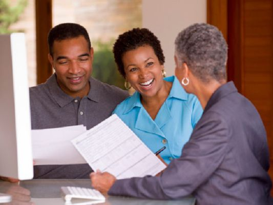 Businesswoman talking with clients
