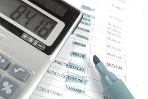 Financial records with a highlighter and calculator