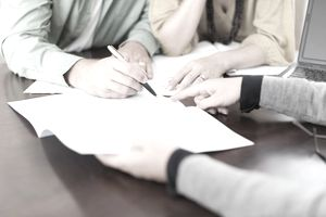 Couple signing loan documents