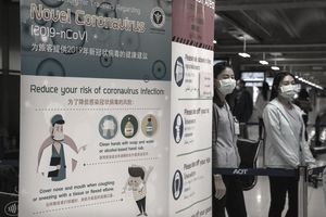 A sign at a Thai airport informers travelers of coronavirus precautions to take.