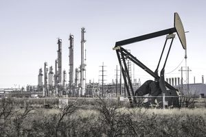 A pumpjack (oil derrick) and oil refinery in Seminole, West Texas.