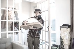 Man receiving home-delivered packages