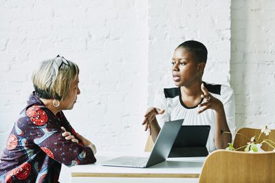 Female financial advisor explaining mutual fund assets to a client