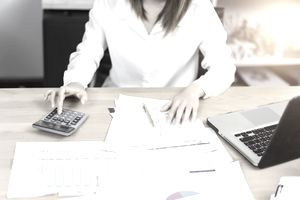 Woman working on investment analysis paperwork