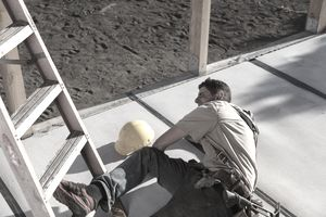 Carpenter building a home at construction site falling off a ladder and injuring leg.