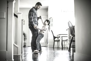 Father dancing with young daughter