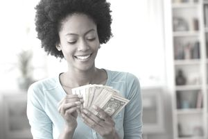 Woman with cash in hand