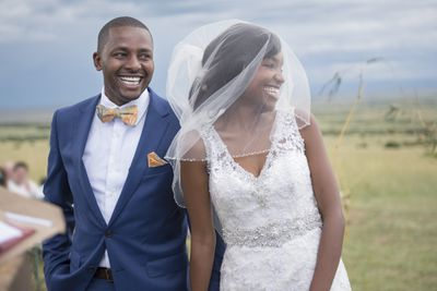 Smiling bride and groom at outdoor wedding ceremony