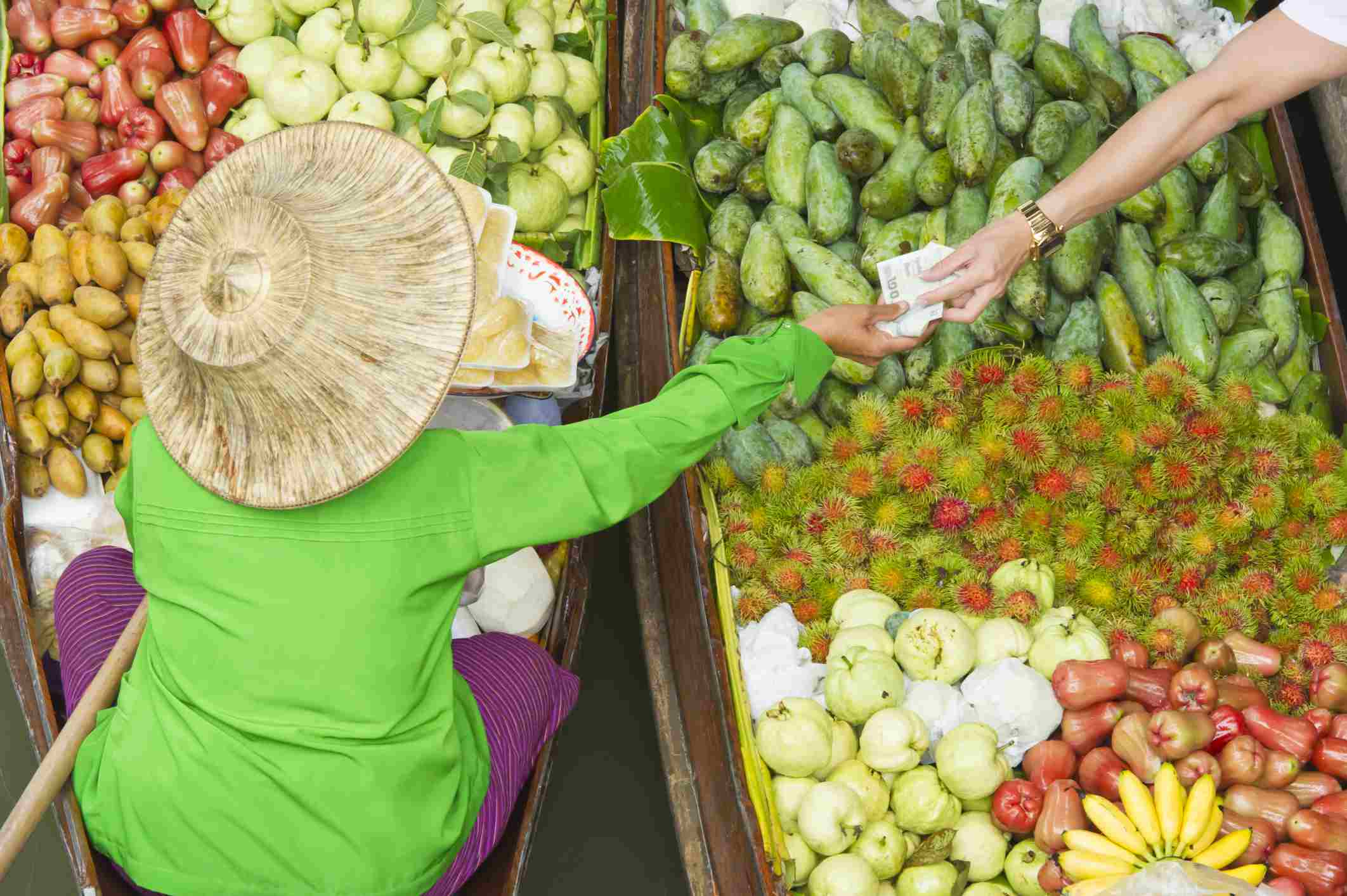 woman trading fruits for money