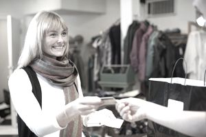 Woman pays for clothing purchase with credit card