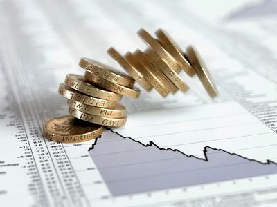 Stack of coins falling on list of share prices