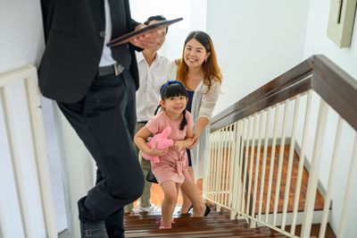 Excited little girl runs upstairs exploring new home