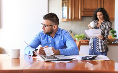 Person holding mortgage paperwork