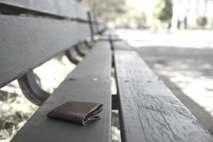 Lost wallet laying on a park bench