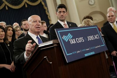Politicians at a podium announcing the Tax Cuts and Jobs Act