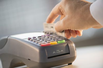 Person using a credit card or debit card