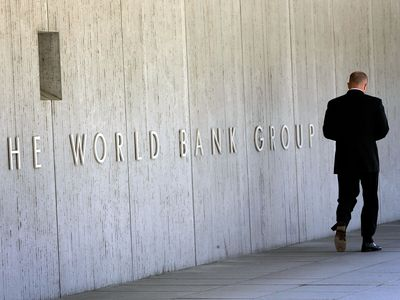 Man walking in front of the World Bank Group building in Washington