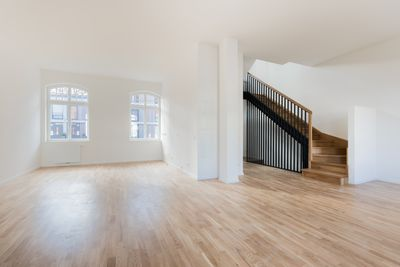 A large, vacant home with a staircase