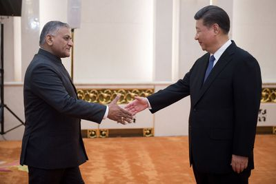 BRICS foreign ministers meet in Beijing, shaking hands